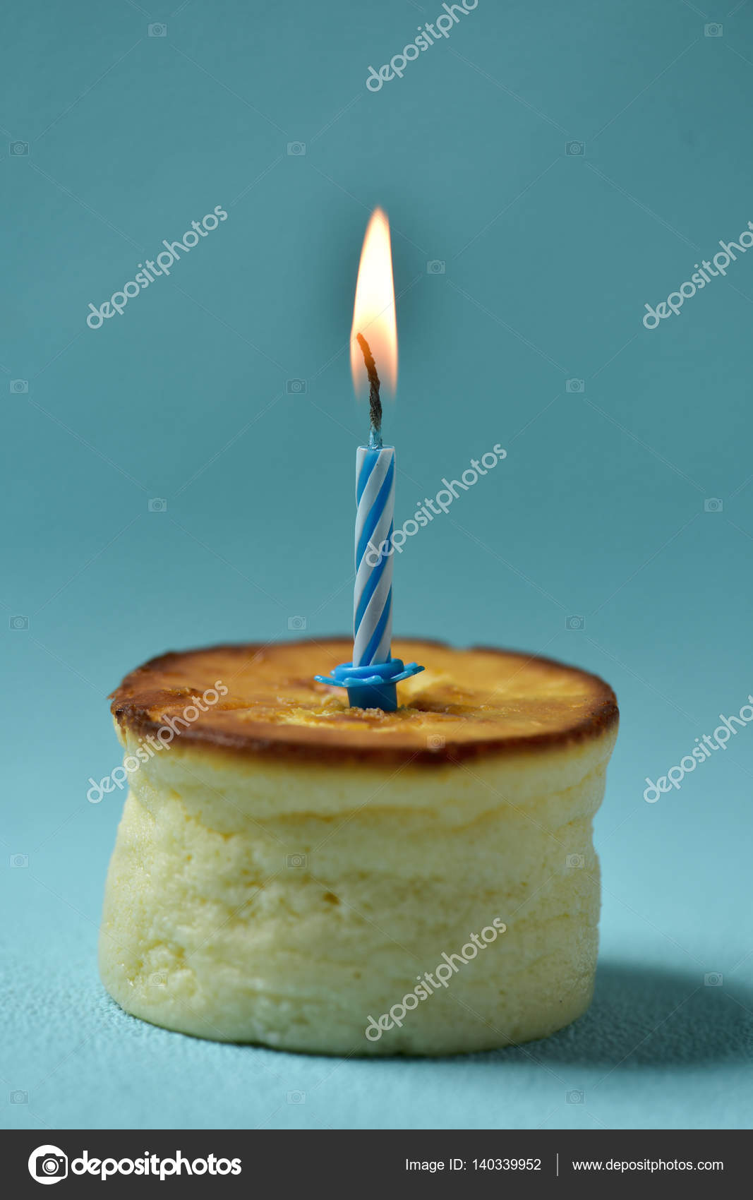 lit birthday candle on a cheesecake stock photo nito103 140339952