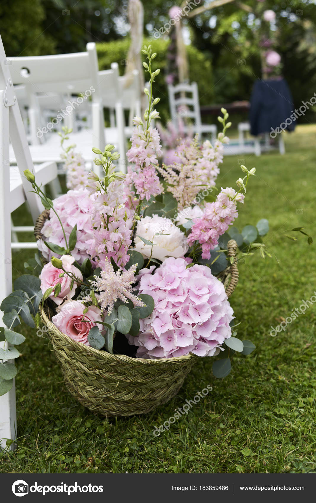 Flower arrangement in an open air wedding ceremony stock photo closeup of an arrangement of different pale pink flowers in a basket as a decoration in an open air wedding ceremony photo by nito103 junglespirit Image collections