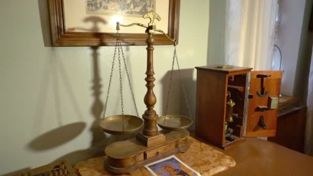 Old Apothecary Scales Are on a Heavy Oak Table. Ancient Microscope is in a Box For Storage