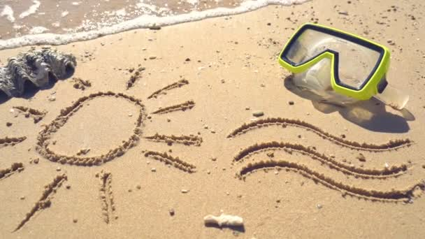 Drawing on the wet sand of the Mediterranean Sea