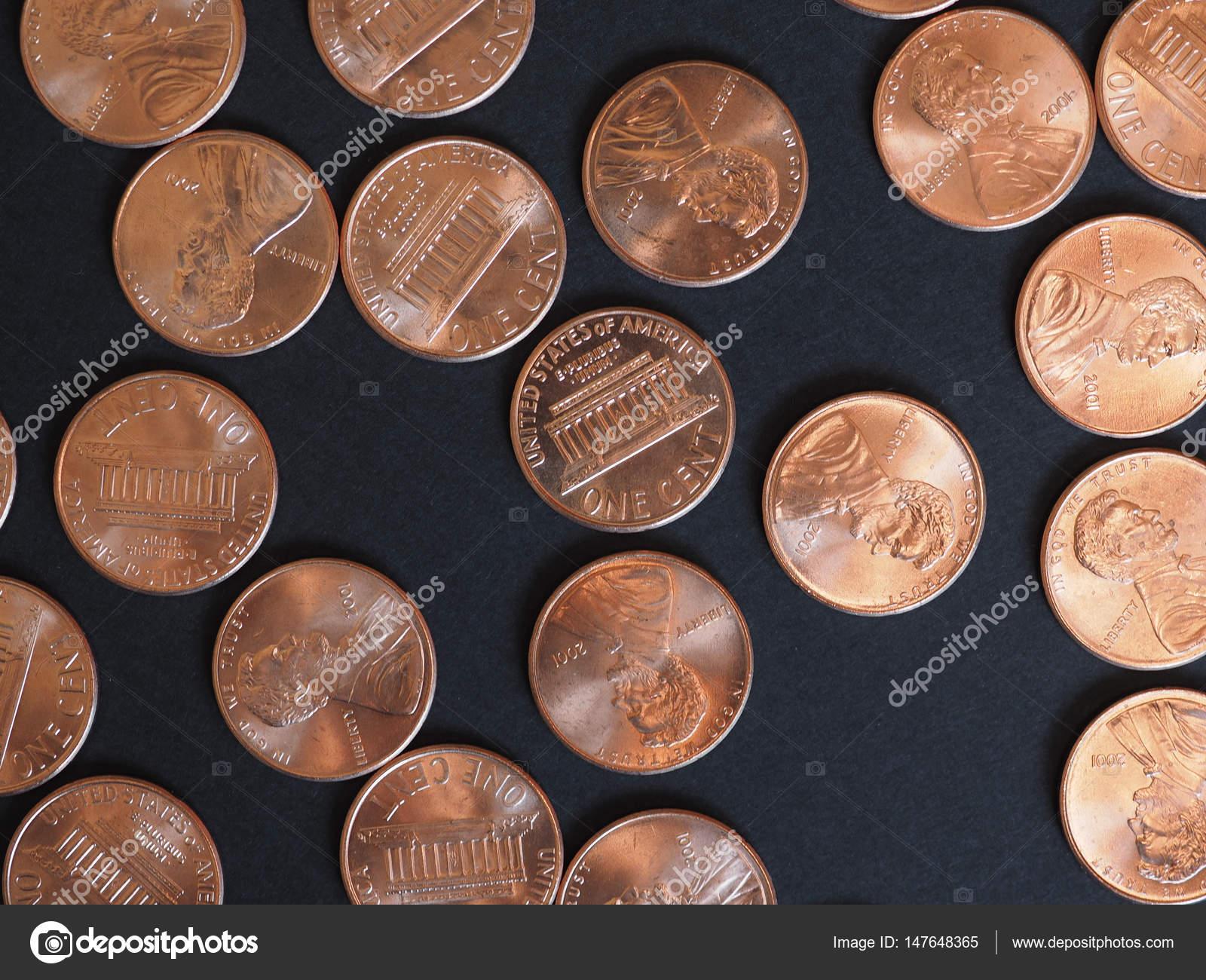 Ein Cent Dollar Münzen Usa über Schwarz Stockfoto