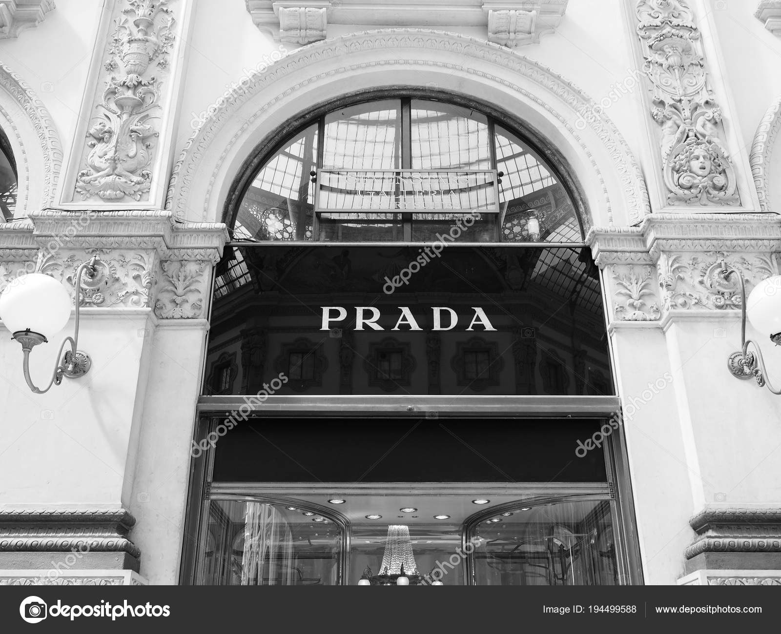 Milan italy circa april 2018 prada store in the galleria vittorio emanuele ii in black and white photo by