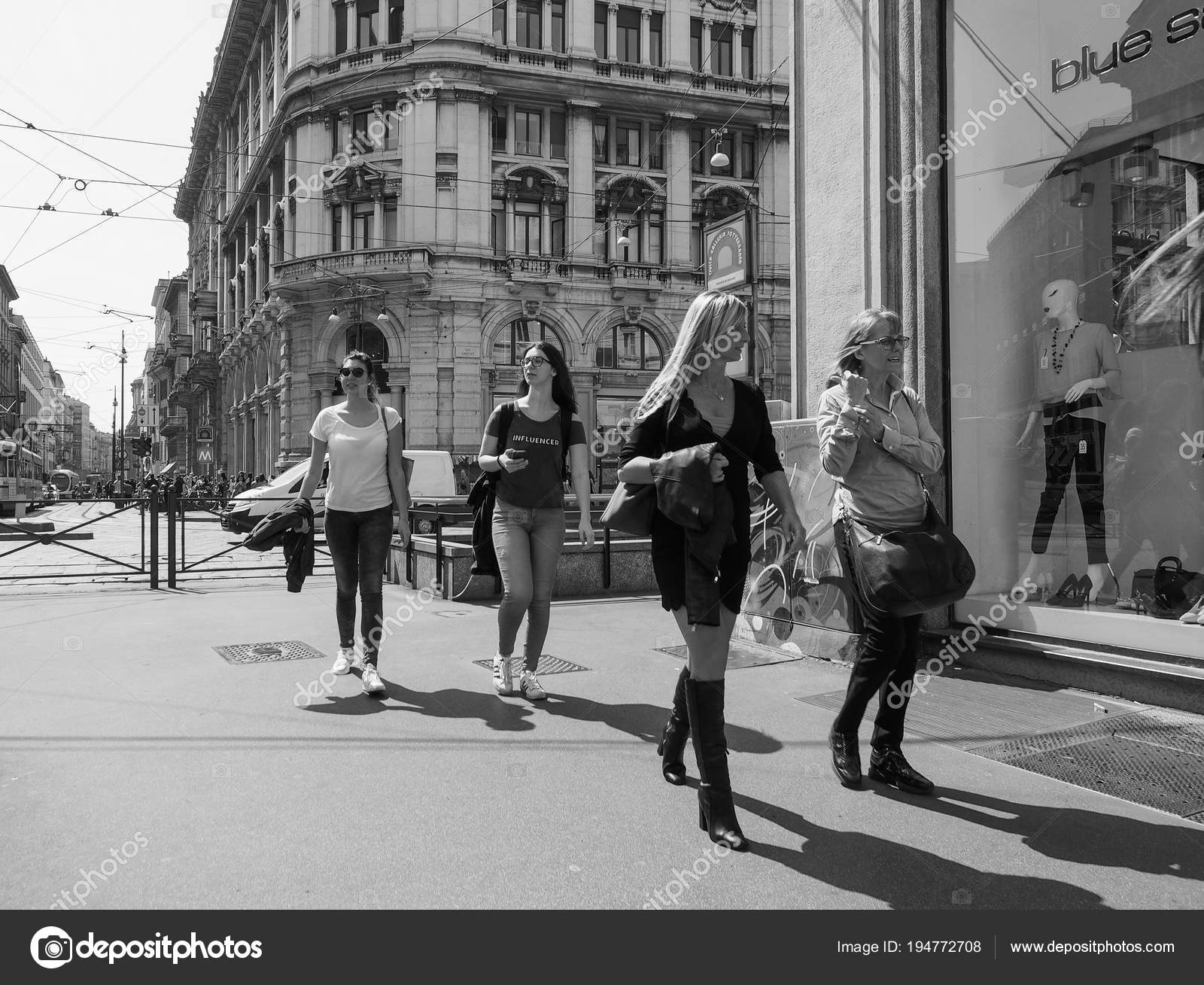 Milan italy circa april 2018 women walking in the city centre in black and white photo by