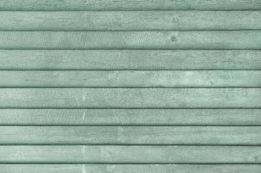 Old light turquoise fence from faded boards. Background for layouts with wood texture