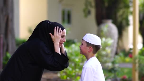 Arabic mother and son together having fun.