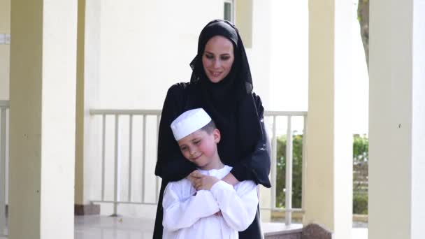Arabic mother and son together outdoors.