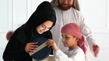 Arabic Muslim family with gift box.
