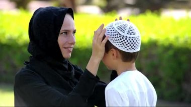Arabic mother and son outdoors.Middle eastern people.
