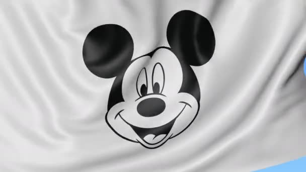 Close up of waving flag with Walt Disney Mickey Mouse logo, seamless loop, blue background. Editorial animation. 4K ProRes, alpha
