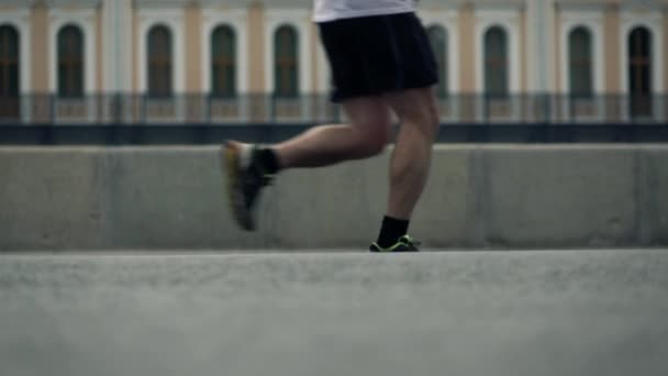 Feet of city marathon runners. Competition concept. Slow motion long shot