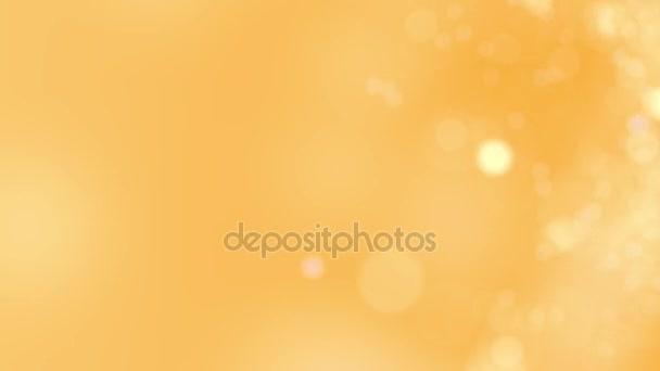 Žlutá pohyb na pozadí. Abstraktní, zářící bokeh kruhy nebo jiskry. 4 k bezešvé smyčka animace