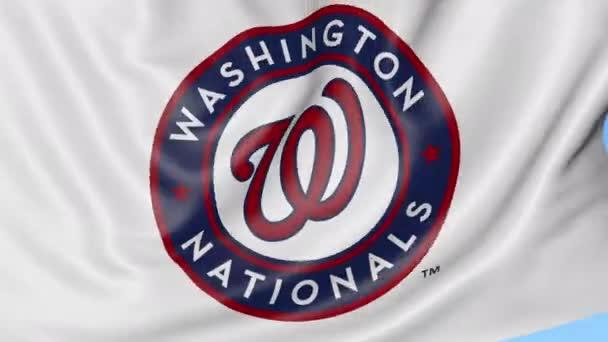 Detail mávat vlajkou s Washington státní příslušníci Mlb baseball tým loga, bezešvé smyčka, modré pozadí. Redakční animace. 4k