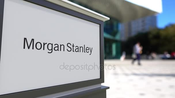 Street signage board with Morgan Stanley Inc  logo  Blurred office center  and walking people background  Editorial 3D rendering 4K