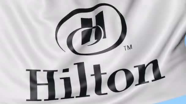 Close Up Of Waving Flag With Hilton Hotels Resorts Logo Seamless