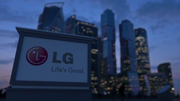Pouliční nápisy deska s logem Lg Corporation ve večerních hodinách. Obchodní čtvrť mrakodrapů pozadí rozmazané. Redakční 3d vykreslování 4k