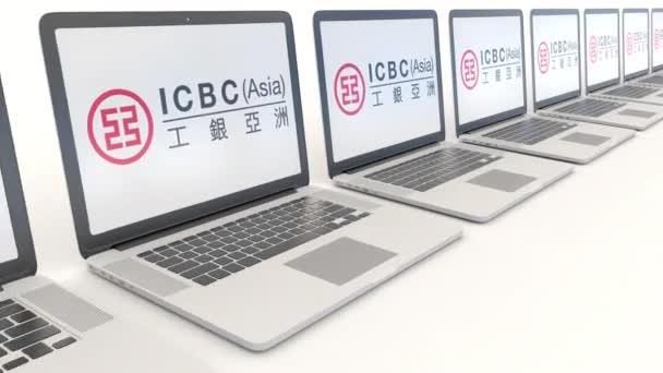 Moderní notebooky s průmyslovou a Komerční banka Icbc Číny loga. Počítač technika koncepční redakční 4k klip, bezešvé smyčka