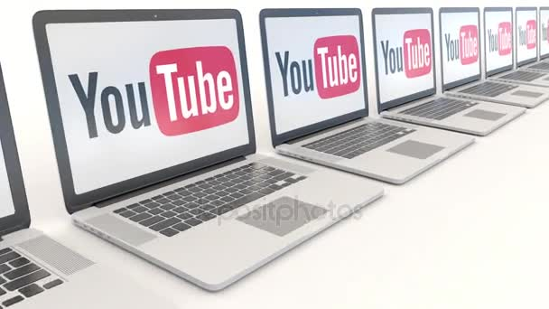 Modern laptops with YouTube logo. Computer technology conceptual editorial 4K clip, seamless loop
