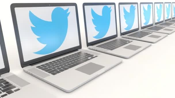 Modern laptops with Twitter, Inc. logo. Computer technology conceptual editorial 4K clip, seamless loop
