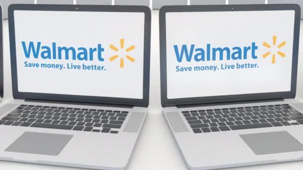 Laptops con el logo de Walmart en la pantalla. Clip de computadora ...