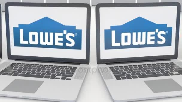 Notebooky s logem Lowes na obrazovce. Počítač technika koncepční redakční 4k klip, bezešvé smyčka