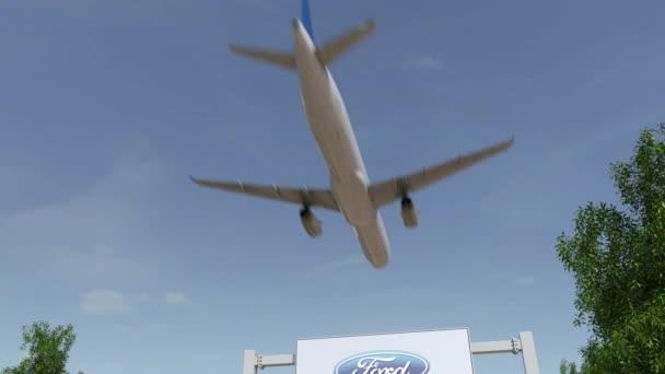 Letadlo letící nad reklamní billboard s logem Ford Motor Company. Redakční 3d vykreslování 4 k klip