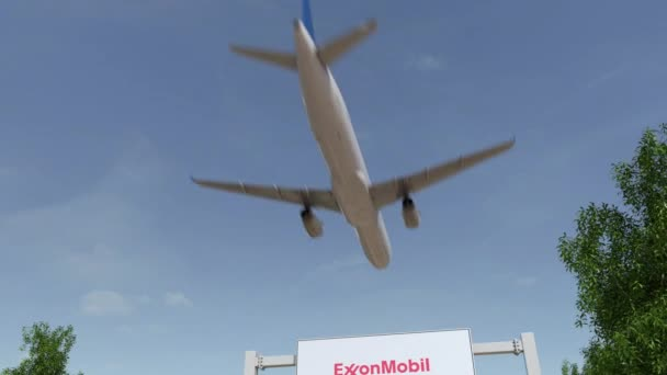 Airplane flying over advertising billboard with ExxonMobil logo  Editorial  3D rendering 4K clip
