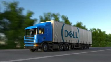 Freight semi truck with Dell Inc. logo driving along forest road, seamless loop. Editorial 4K clip