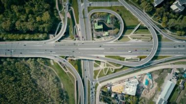 WARSAW, POLAND - MAY, 2, 2017. Aerial shot of road junction on a sunny day, top down view. 4K video