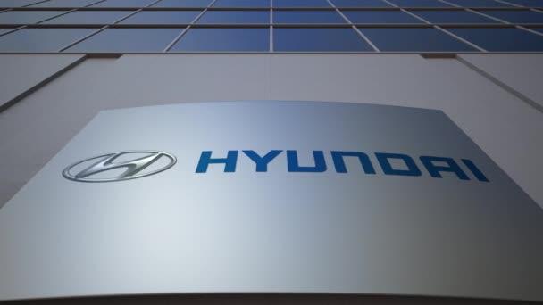 Venkovní značení deska s logem Hyundai Motor Company. Moderní kancelářská budova. Úvodník 3d vykreslování