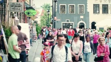 WARSAW, POLAND - JUNE 10, 2017. Tourists walk along old town street on a summer day
