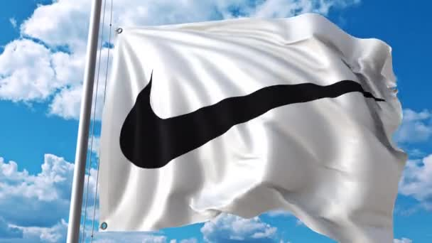 Waving flag with Nike logo against moving clouds. 4K editorial clip — Video  by alexeynovikov