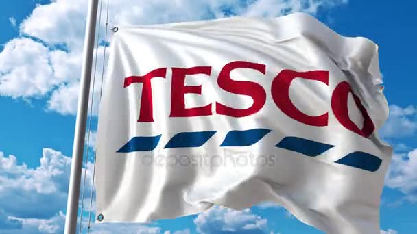 Waving flag with Tesco logo against moving clouds  4K editorial animation