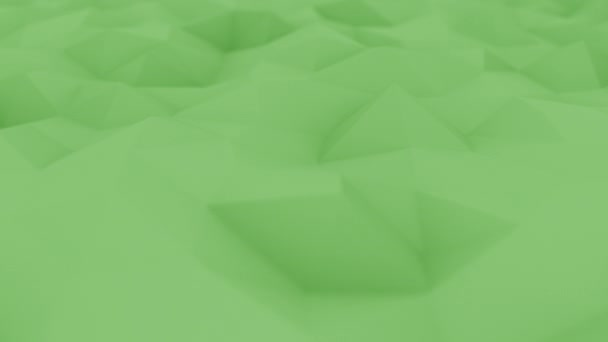 Abstraktní polygonální zelené plochy, mělké soustředit close-up. Loopable pohybu pozadí