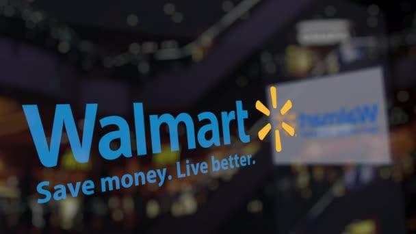 Logo de Walmart en el centro de negocios borrosa del vidrio ...