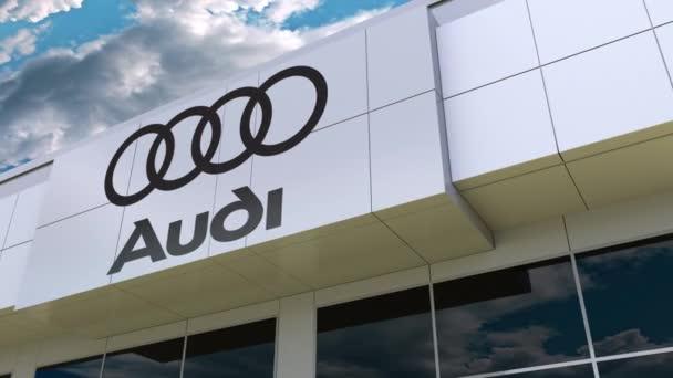 Audi logo na fasádě moderní budovy. Úvodník 3d vykreslování