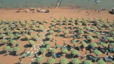 Aerial view of a big crowded sandy beach in Lido di Jesolo, Italy. Summer vacation time