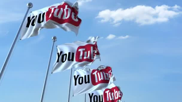 Waving flags with Youtube logo against sky, seamless loop. 4K editorial animation