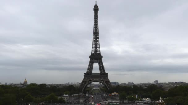 Iconic time lapse of crowded Champ de Mars and the Eiffel tower in Paris, France