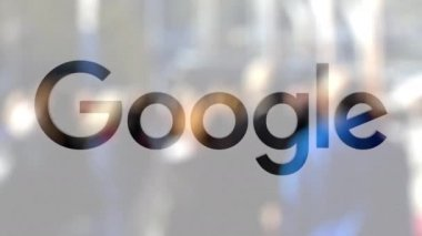 Google logo on a glass against blurred crowd on the steet. Editorial 3D rendering