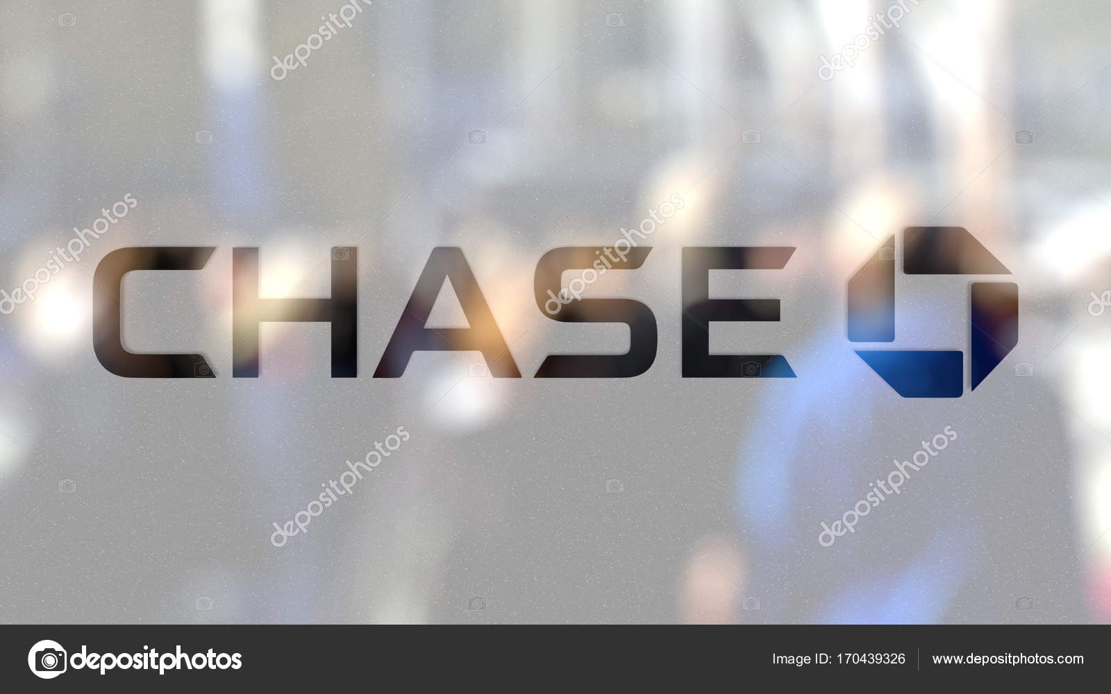 JPMorgan Chase Bank logo on a glass against blurred crowd on the