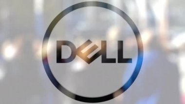 Dell Inc. logo on a glass against blurred crowd on the steet. Editorial 3D rendering