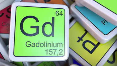 Gadolinium Gd block on the pile of periodic table of the chemical elements blocks. 3D rendering