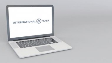 Opening and closing laptop with International Paper logo. 4K editorial animation