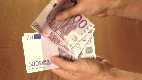 Man counting five hundred euro banknotes. Savings, salary or spending concepts