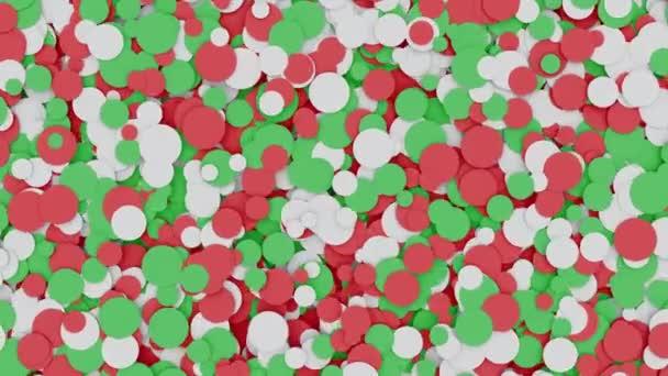 Abstraktní pohybující se červené, bílé a zelené kruhy pohybové pozadí