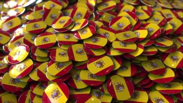 Pile of badges featuring flags of Spain