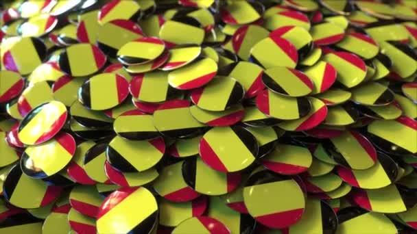 Pile of badges featuring flags of Belgium