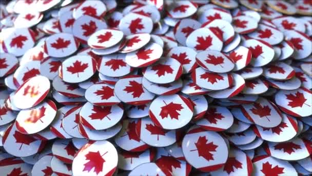 Pile of badges featuring flags of Canada