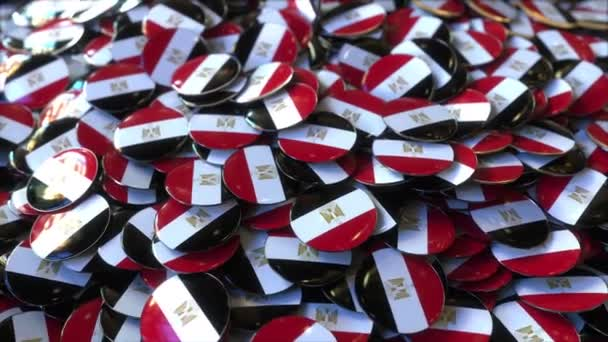 Pile of badges featuring flags of Egypt