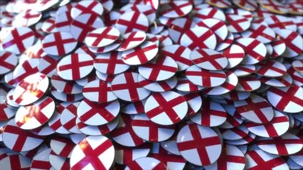 Pile of badges featuring flags of England